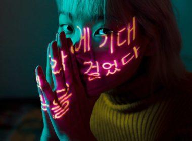 photo of woman wearing yellow sweater